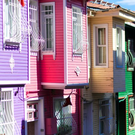 Row Of Colourful Exterior Wood Houses